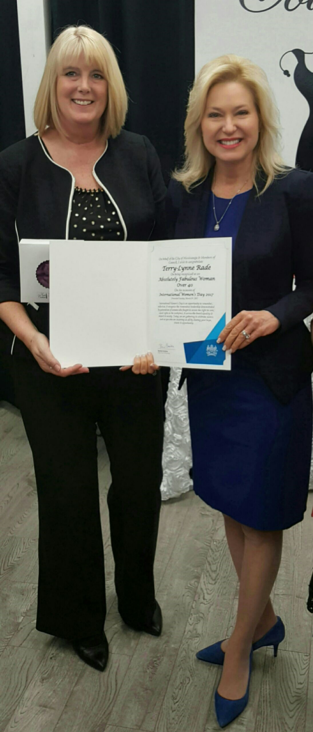 Owner of First Class Home Care, Terri-Lynne Rade presented with award from Misssissauga Mayor Bonnie Crombie